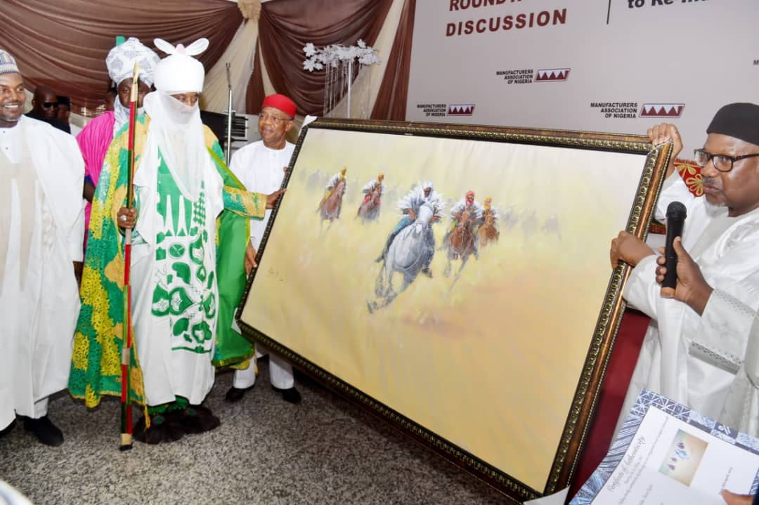 MAN President and former President, Dr Frank Jacobs MON presents a gift to the Emir as Guest speaker